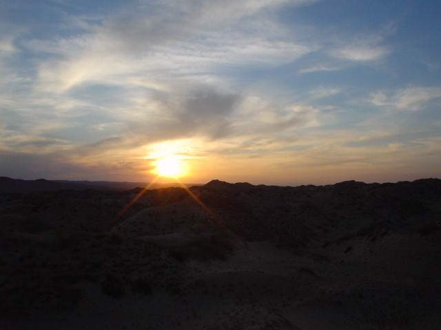 Sunset on top of a sand dune