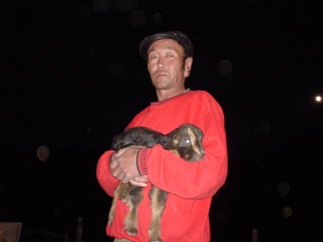 Our driver, Lasa, with a baby goat